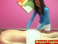Skinny asian masseuse tugging on client
