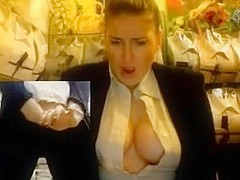 woman in store plays with her scoops and cum-hole on web camera