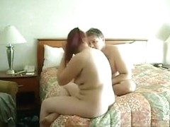 Ponytailed redhead wife sucks her man's cock and gets fingered